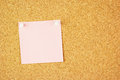 Pink clear sticker pined on the cork corkboard your text Royalty Free Stock Images
