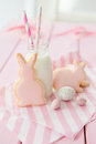 Pink cookies and milk in a vintage bottle Royalty Free Stock Image