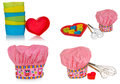 Pink cooking hat, with multi-colored pattern, hearts, flowers and owls. Hearts molds for cookies in red. Whisk to froth Royalty Free Stock Photo