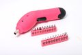 Pink cordless screwdriver and bits in different sizes on a white background Royalty Free Stock Images