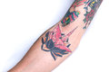 Pink crane black lotus forearm tattoo a of an origami with a cherry blossom pattern on a surrounded by bits of other tattoos on a Royalty Free Stock Photo