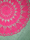 Pink crochet texture on linen fabric Stock Photo
