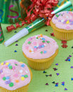 Pink cup cakes green background Royalty Free Stock Photo
