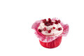 Pink cupcake with icing isolated on white Royalty Free Stock Image