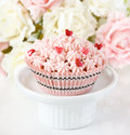 Pink cupcake sweet on a cake stand Royalty Free Stock Photography