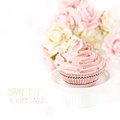 Pink cupcake sweet on a cake stand with roses and bokeh Stock Photos