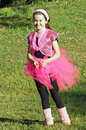 Pink dancer in park Royalty Free Stock Photo