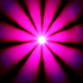 Pink disco dance light in a bright sun star shape shining Stock Photos