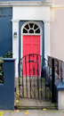 Pink door pathway residential entrance with metal gate and Stock Photos