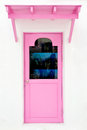 Pink door with sunshade Royalty Free Stock Photo