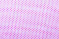 Pink dot pattern on textured fabric Royalty Free Stock Photo