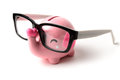 Pink elephant piggy bank with glasses isolated on a white background Royalty Free Stock Photo