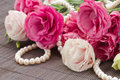 Pink eustoma flowers and pearls border isolated on white background Stock Photo