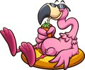 Pink flamingo with sunglasses resting on a lifesaver and having a tropical drink Royalty Free Stock Photo
