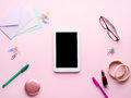 Pink flat lay with gadget stationery glasses lipstick Royalty Free Stock Photo