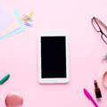 Pink flat lay with gadget stationery glasses lipstick