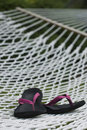 Pink flip flops on backyard rope hammock summer Royalty Free Stock Photos