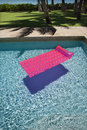 Pink float in swimming pool. Royalty Free Stock Photos