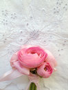 Pink flowers on butterfly eyelet fabric small bouquet of ranunculus white with a motif Stock Images