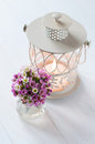 Pink flowers and candle lantern festive wedding decor bouquet of on a white wooden board Royalty Free Stock Photography