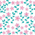 Floral seamless pattern. White flowers and outlines of leaves on a blue background.