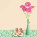Pink flowers and girly shoes in a blue vase with Stock Photo