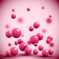 Pink fruit balls on abstract background.