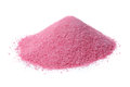 Pink fruit juice powder concentrate isolated on wh a heap of instant raspberry a white background Stock Photography