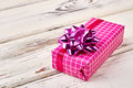 Pink gift box with bow.