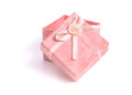 Pink gift box with bow on a white baxkground Royalty Free Stock Photos