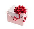 Pink gift box with red ribbon and bow on white Royalty Free Stock Photography