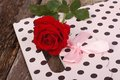 Pink gift paper bag and a red rose on the table Royalty Free Stock Images