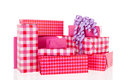 Pink gifts with checked wrapping paper and bow Stock Image