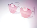 Pink glasses as lifestyle on light purple background Stock Photo