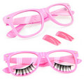 Pink glasses false eyelashes fake nails Royalty Free Stock Photo