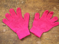 Pink gloves on a wooden table Royalty Free Stock Photography