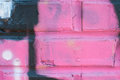 Pink graffiti art covers brick wall paint with markings the of an abandoned warehouse Royalty Free Stock Photo
