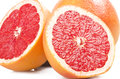 Pink grapefruit close up on the white Royalty Free Stock Photography