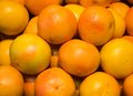 Pink grapefruit on display at the supermarket Royalty Free Stock Photography