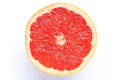 Pink grapefruit slice isolated #2 Royalty Free Stock Photo