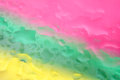 Pink green and blue water drop background. Royalty Free Stock Photo