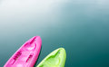 Pink and green canoe on lake Royalty Free Stock Photo