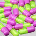 Pink and green pills Stock Images