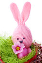 Pink handmade easter bunny with easter eggs and spring flowers Royalty Free Stock Photo