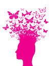 Pink head silhouette and butterflies flying out of the of a human Royalty Free Stock Photos