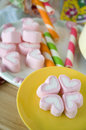 Pink heart marshmallow yellow plate Stock Photo
