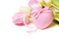 Pink heart with ribbon and flowers. Stock Image