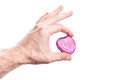 Pink heart shaped stone in mans hand Royalty Free Stock Image