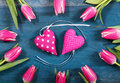 Pink hearts with tulips on wooden background Royalty Free Stock Photos