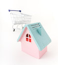 Pink house and shopping trolley Stock Image